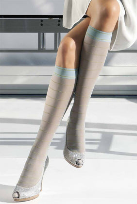 Close up of lady's lower legs in sheer aqua knee highs and heels.