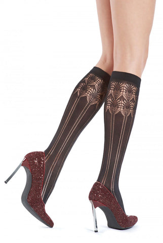Close up of lady's lower legs wearing Oroblu brown melange Penny knee high socks in burgundy shoes.