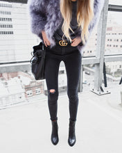 Dark Grey Ostrich Feather Jacket worn with black skinny jeans and gucci belt