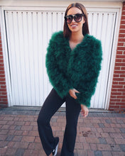 TOWIE and First Time Mum Ferne Mccann wears emerald green ostrich feather jacket