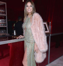 Heidi Klum wears AIYA ostrich feather jacket