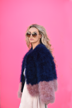 navy and blush pink ostrich feather jacket as worn by model brooke who wears designer sunglasses and gucci handbag