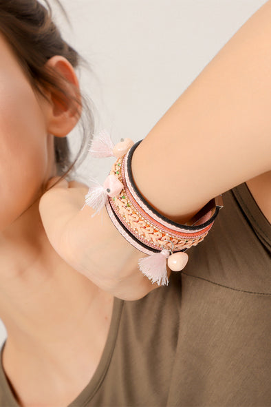 Braided Pink Bracelet With Tassel