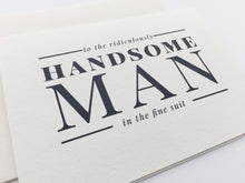 A close-up look at the Man in the Fine Suit wedding card paired with a cream envelope / by Happy Ever Paper