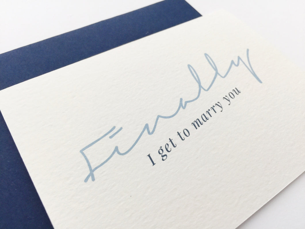 A close-up view of the Finally wedding card paired with a navy blue envelope / by Happy Ever Paper