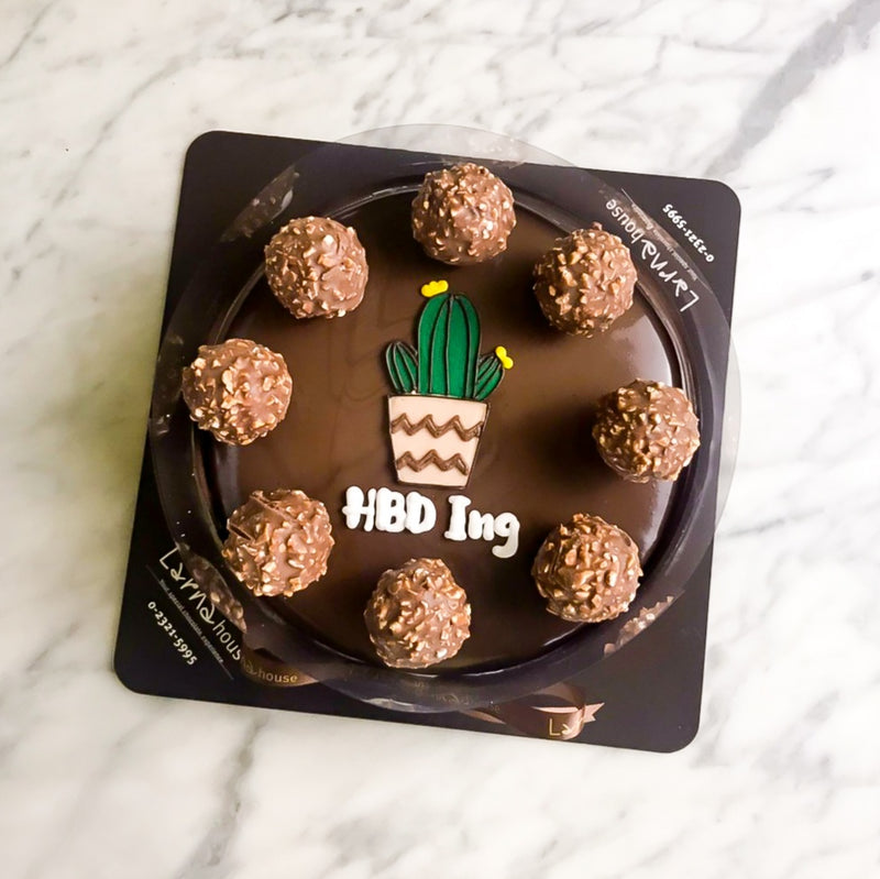 Ferrero chocolate with cartoon drawing on larna cake