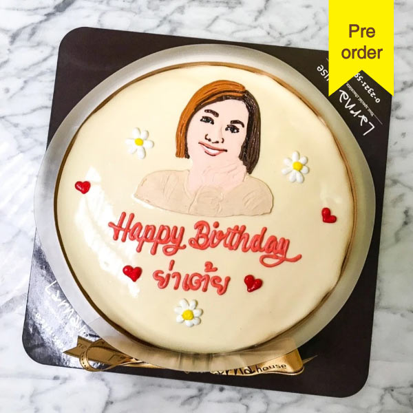 White Larna cake with portrait drawing