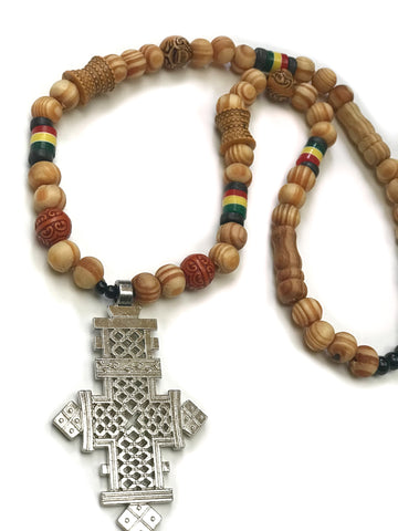 Modern Orthodox Ethiopian cross necklace on cedar wood beads