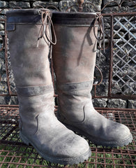 orca bay country boots with mud