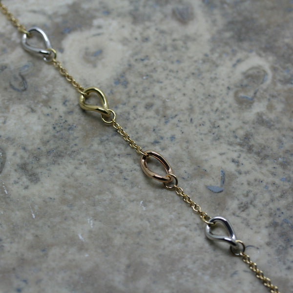 S & CO 18ct Triple Coloured Gold 'Twisted' Link Bracelet