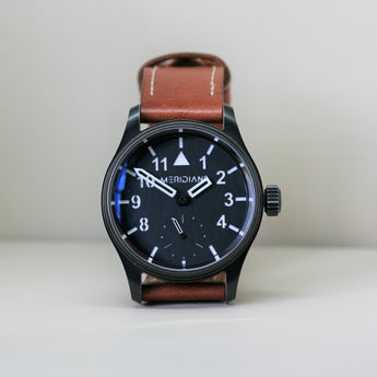 Seven Friday antique finish wristwatch with brown leather strap and black dial