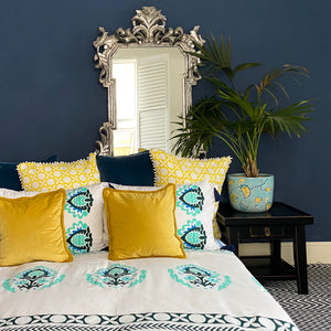 Luxury 300 thread count organic cotton pillowcases, printed with sea green and dark green floral elements with navy tassels.