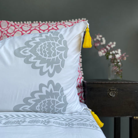 Beautiful grey floral designs on crisp white luxury organic cotton pillowcases.  Finished with removable sunny yellow tassels.