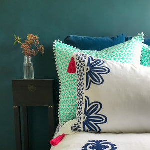Navy floral designs on crisp white luxury organic cotton pillowcases.  Finished with pink removable tassels.