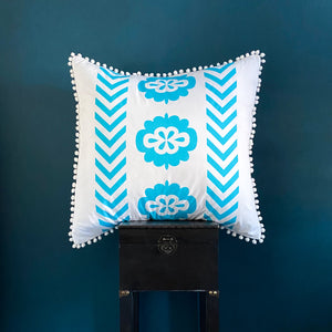 Bright aqua blue printed organic European cushion cover with white pompom trim