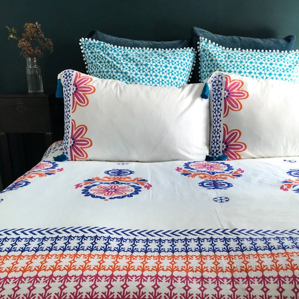 Luxury geometric inspired brightly coloured orange, blue and pink organic duvet cover