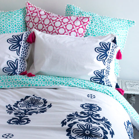 navy blue floral print with a sea green geometric reverse, 100% luxury organic cotton duvet cover and matching pillowcases