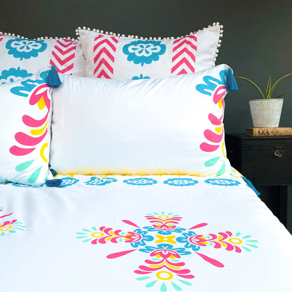 Spring yellows, blues and pinks are zesty in this luxury organic duvet set, finished with European pillows.