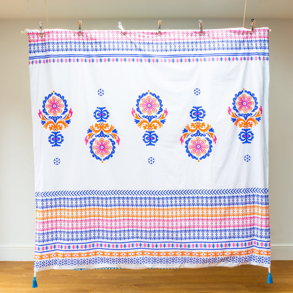 Luxury organic floral print orange, blue and pink duvet cover with bright blue removal tassels