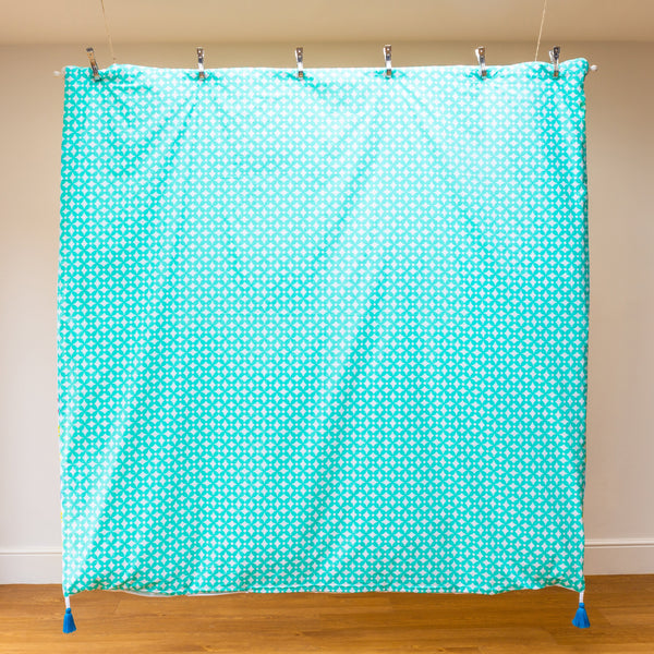 Luxury organic duvet in seagreen geometric print finished with bright blue removable tassels