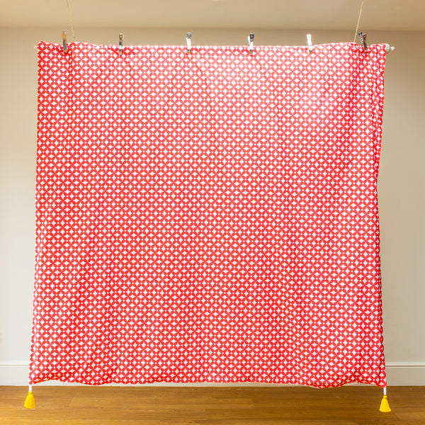 Luxury organic duvet cover reverse in coral geometric print with sunny yellow tassels