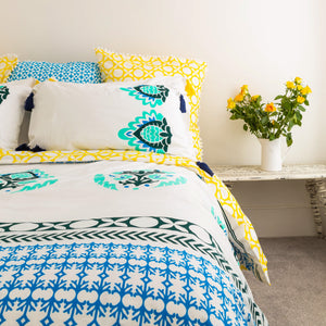 Luxury organic duvet cover and pillowcases in sea greens and sunny yellow with navy removable tassels