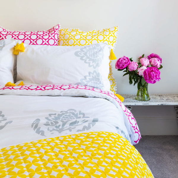 Grey florals accented with pop pink geometric reverse in this luxury organic duvet cover with matching pillowcases