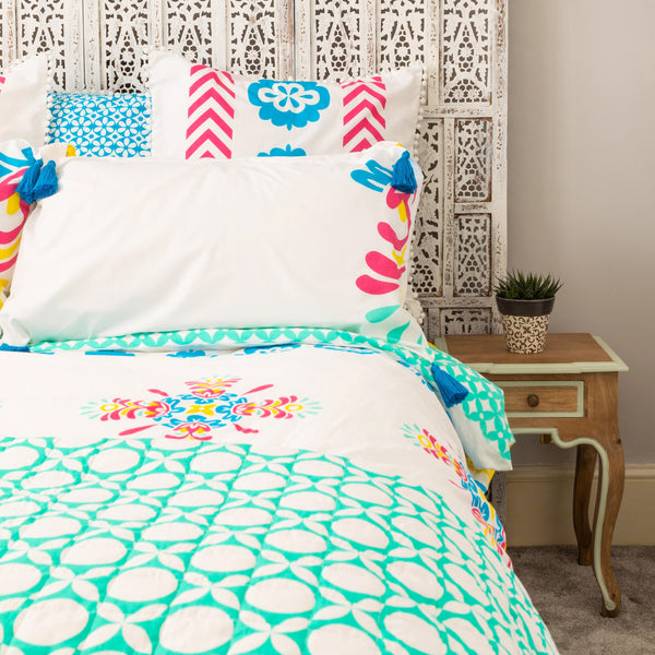 Luxury organic standard pillowcases in bright pink, blue and yellow with removable blue tassels