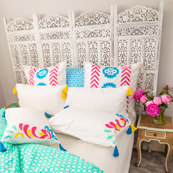 Bright coloured standard, European pillows frame a luxury bright coloured organic duvet cover