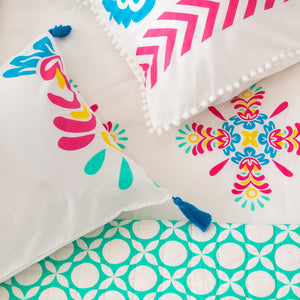 Bright pink, blue and yellow standard pillowcases with vibrant removable blue tassels