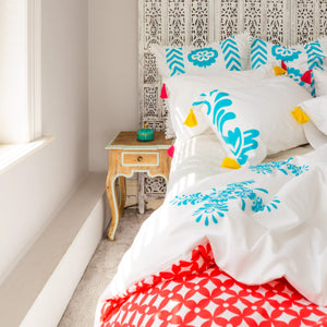 Luxury coral geometric print organic reversible duvet cover with coordinating bright aqua blue pillows