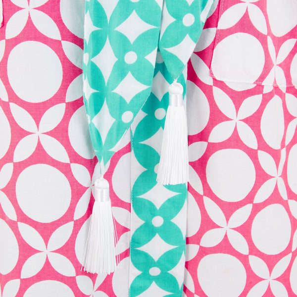 White silk tassel detail on pink geometric printed robe