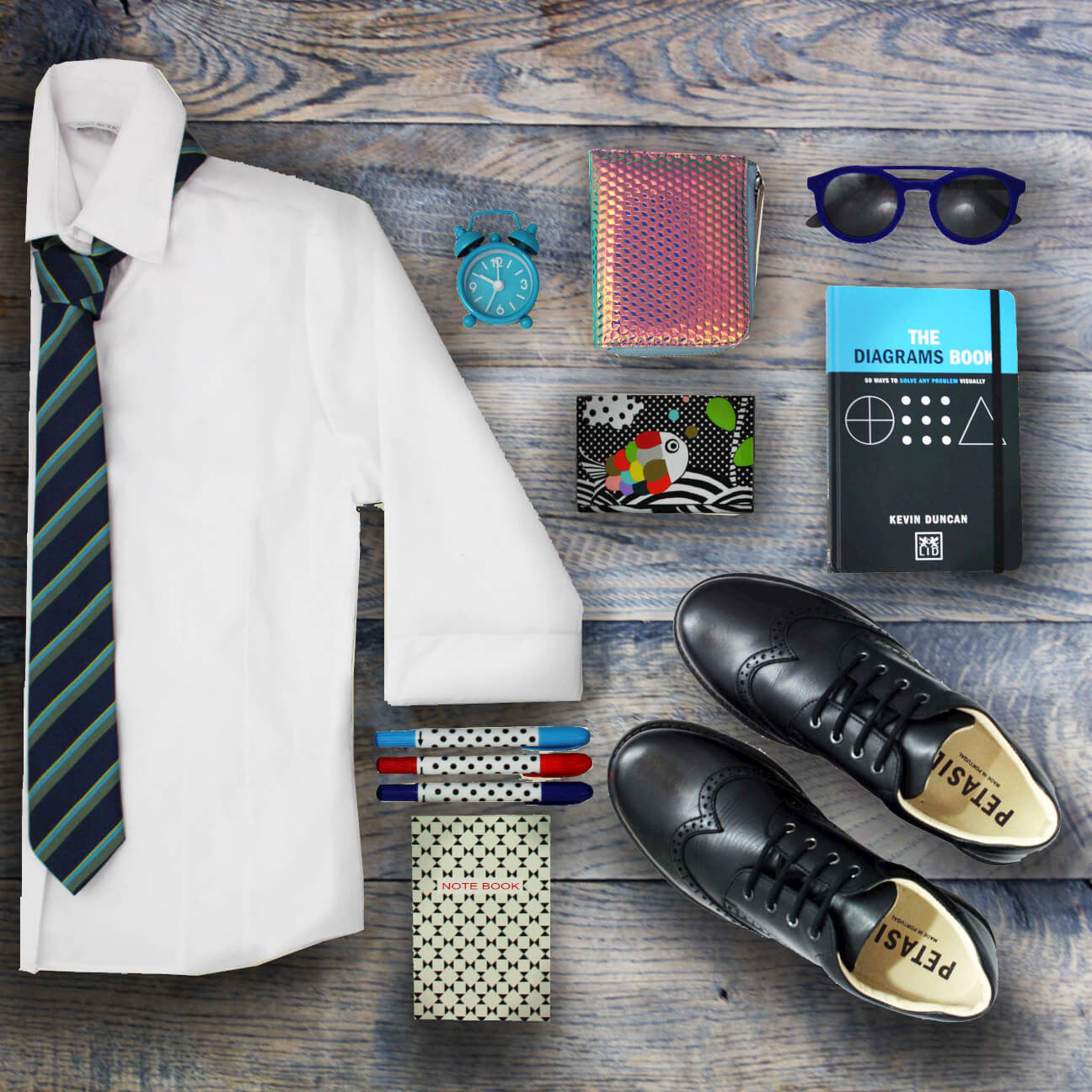 flat lay image of back to school items.  black shoes, sunglasses, notepad, pens, shirt tie