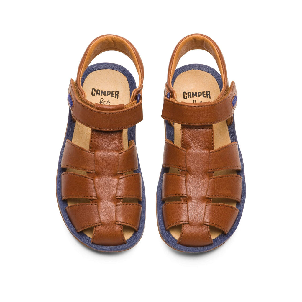 Top view of Pair of Camper Dione Race Tan Closed Sandals. Cooshoo kids shoes.