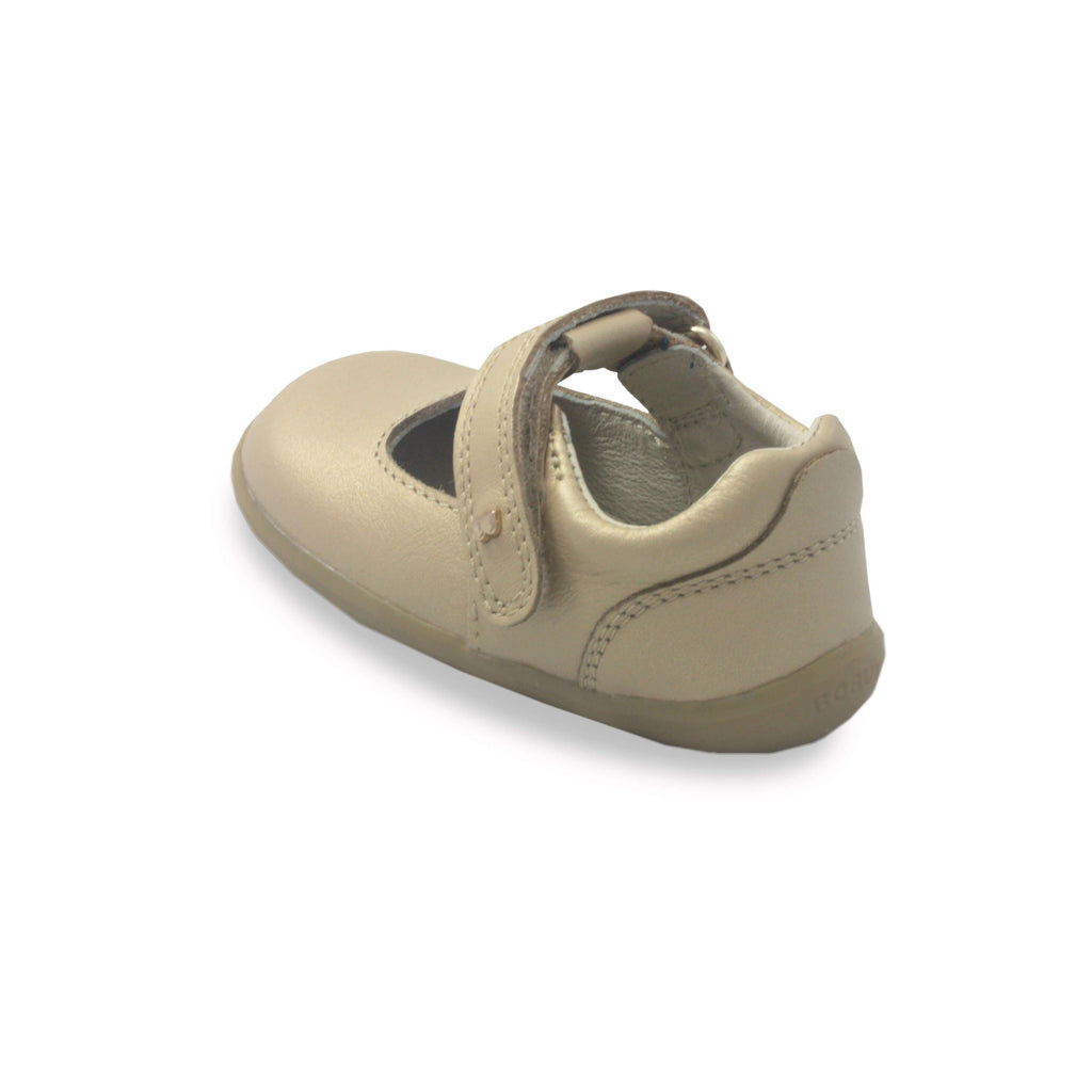 Bobux Step Up Delight gold mary-jane barefoot children's shoes. From Cooshoo fitted childrens shoes. Heel view.