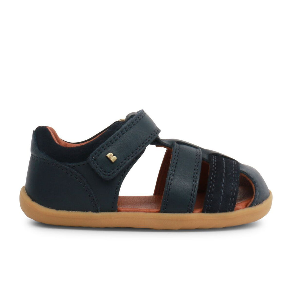 Side view of Bobux Step Up Roam Navy Closed Sandals, barefoot children's shoes. From Cooshoo fitted childrens shoes.