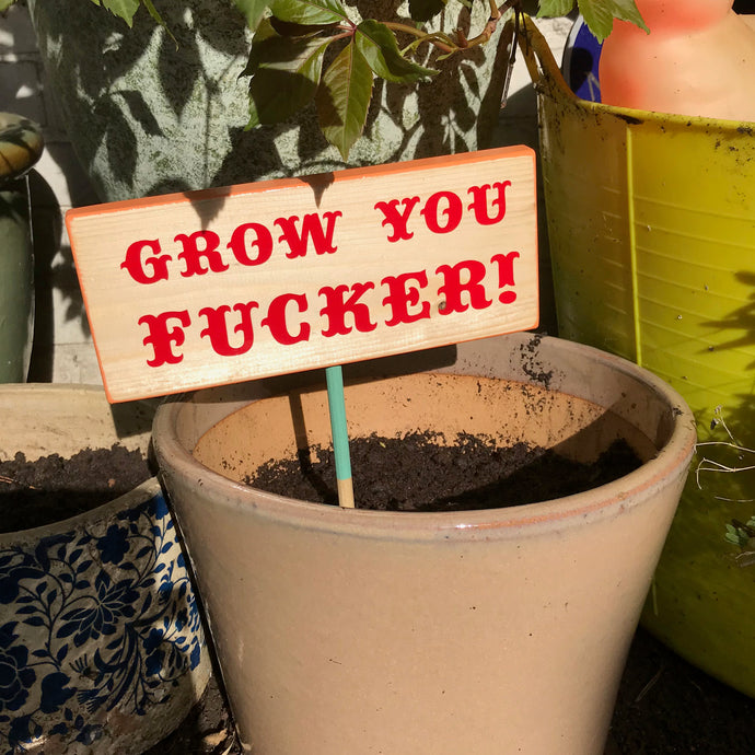 'grow you fucker' garden sign