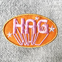 HAG iron-on clothes patch