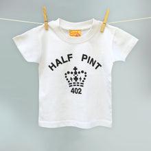 Child's white organic t shirts with a black Half Pint logo