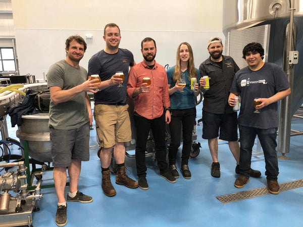 The True North Ale Company brewery staff with glasses of the winning batch of Vincianne.