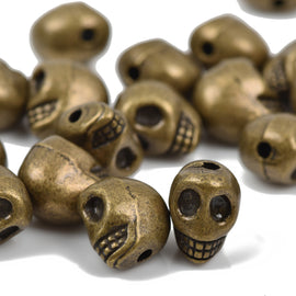 5 Bronze Metal SKULL Beads, drilled top to bottom, 18mm, bme0398