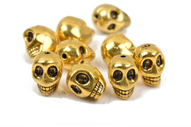 5 Gold Metal SKULL Beads, drilled top to bottom, 18mm, bme0400