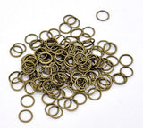 Antique Bronze Open Jump Rings 9x1mm . package of 500 . jum0078