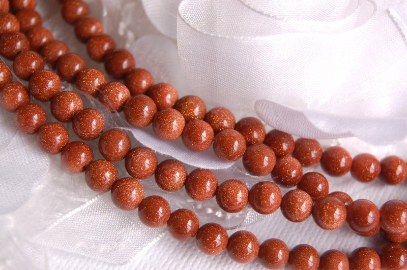 GOLDSTONE Round Beads 6mm . 1 long strand . about 65 beads ggs0005