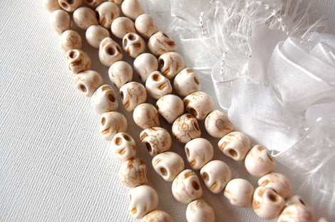 Ghostly White Howlite SUGAR SKULLS Gemstone Beads . 1 long strand . approx 33 beads . carved stone how0387