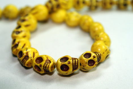 1 Strand LEMON YELLOW Sugar Skulls Howlite Gemstone Beads . approx 32 beads . carved stone  12mm HOW0149