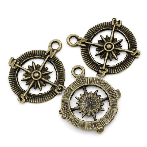 10 Antique Bronze Tone Metal COMPASS Charm Pendants. CHB0090