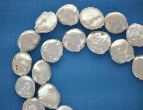 4 Cultured Freshwater Pearls . Round Coin Disc Shape . Off White with pretty pearly surface. 16mm gpe0019