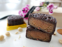 Gluten Free Bakery Paleo and Vegan Mooncake, chocolate skin with hazelnut praline filling and salted caramel center