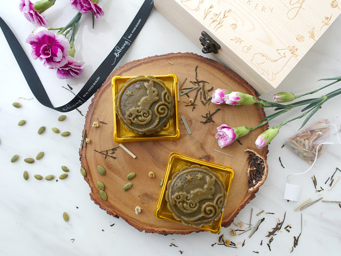 Gluten and Dairy Free Bakery Vegan and Paleo Mooncakes, matcha filling with orange skin and strawberry compote center